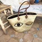 panier marocain tressé main motif oeil
