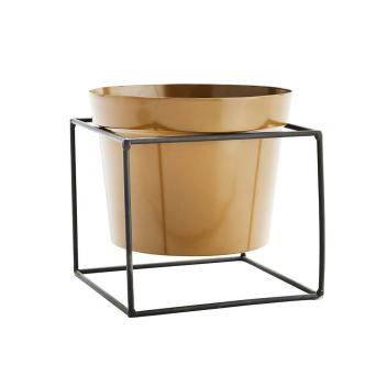 Pot pour plantes en métal moutarde et sa structure en métal noir